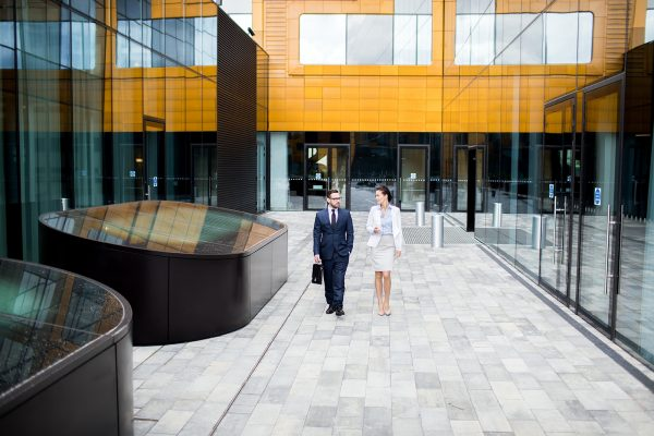 talking-coworkers-walking-on-building-terrace-UD2KVMA.jpg